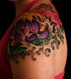 Red and Back Floral Shoulder Tattoo