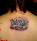 Upper Back Skull Tattoos For Girls