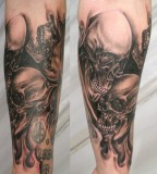 Wonderful Skulls in Flame Inspired Arm Tattoos