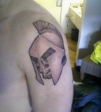 Skull With A Spartan Helmet On It