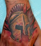 On Hand Spartan Helmet Tattoos