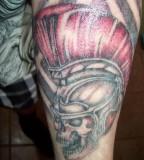 Skull With Spartan Helmet Arm Tattoo
