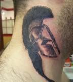 Spartan Helmet Tattoo On The Neck