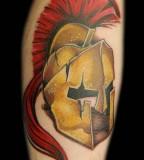 Bronze Spartan Helmet Tattoo On Arm
