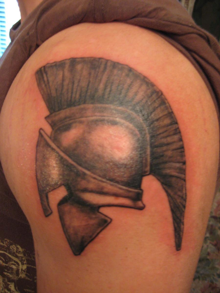 Kenyon Martin Lips Tattoo Arm spartan helmet tattoos