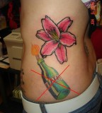 Stargazer Lily and Bottle Tattoo Design on Side for Women