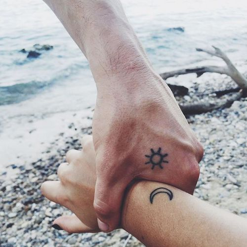 sun and moon on hand couple cattoo