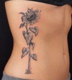 Sunflower Tattoo Design on Rib for Women