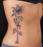 Sunflower Tattoo Design on Rib for Women