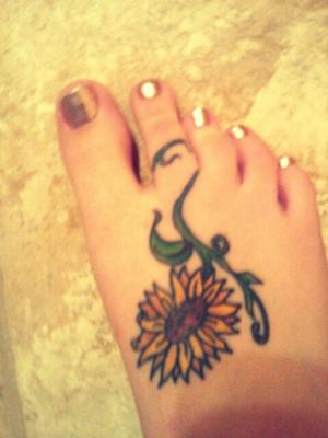 Cute Sunflower Tattoo On Foot For Women Tattoomagz