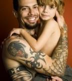 Man with Amazing Tribal Tattoos Design