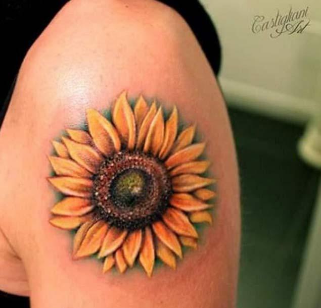 sunflower upper arm tattoo