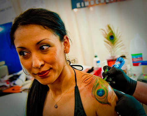 Cute peacock tattoo design on shoulder for women for Tattoo expo san diego