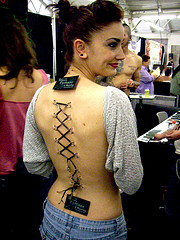 Cool shoelace tattoo design on back for women for Tattoo expo san diego