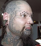Man with Awesome Full Face Tattoo Design