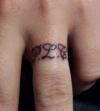 Charming Ring Finger Tattoo Design Picture