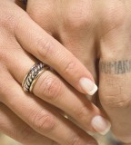 Sweet Scripture Tattoo Design on Ring Finger