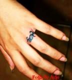 Unique Ring Finger Tattoo Design Pic
