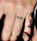 Simple Looking Tattoo Design on Ring Finger