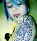 Girl With Arm Tattoo and Piercing
