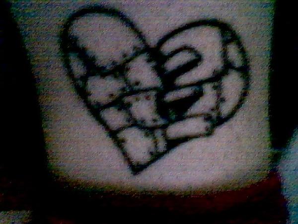 broken heart on inner ankel tattoo