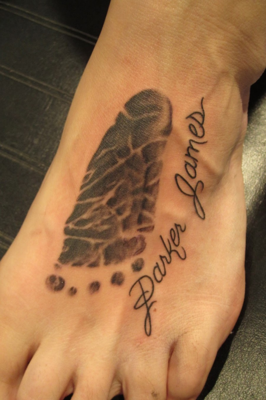 Sole Shaped Symbolizing Family Tattoo Design On Foot Tattoomagz