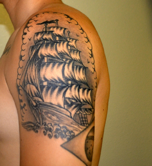 Cool pirate ship tattoo on left upper arm by full circle for Cool upper arm tattoos