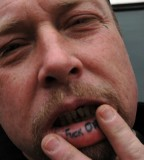 Teardrop And Inside Lip Tattoos For Man