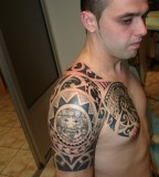 Cool Tribal Tattoo Design on Arm for Men