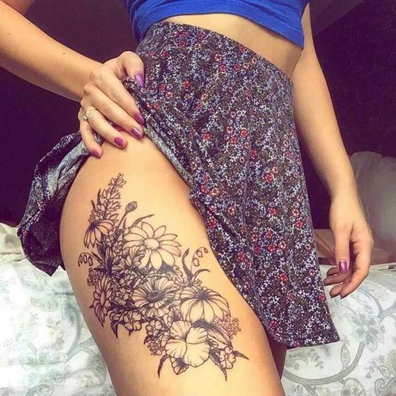 thigh flower tattoo