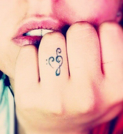 Finger With Bass And Treble Clef Heart Tattoo
