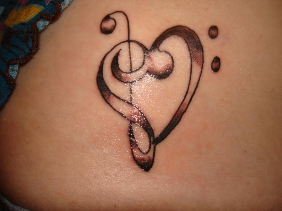 Bass Clef And Treble Clef Tattoo – Upper Back Tattoos