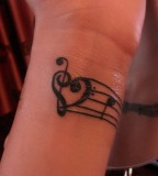 Treble Bass Clef Heart Tattoo With Note At Wrist
