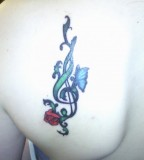 Cute Butterfly and Rose Treble Clef Tattoo