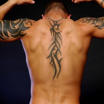 Half sleeve and spine tribal tattoo design for men for Tribal tattoos on back for guys