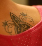 Artistic Back Swirly Trinity Knot Tattoo Design for Girls