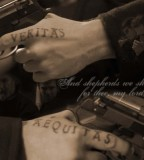 Clay Veritas Et Aequitas Tattoo on Fingers