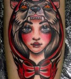 Woman With Head of Wolf Tattoo