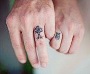 Animals tattoos on fingers