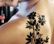 Black shoulder tattoos