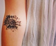 Girl's body sunflowers tattoos