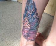 Gorgeous wings tattoos on legs