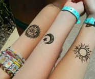 Moons tattoos on arms