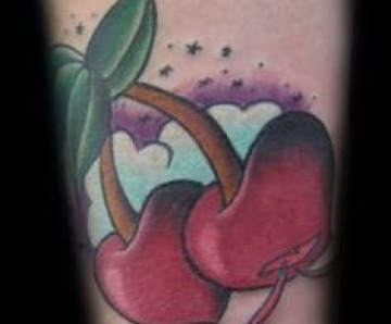 Adorable cherries tattoos on arm