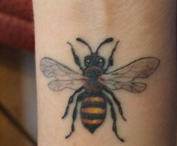Bees tattoos on arms