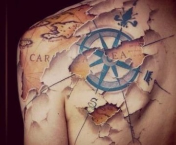 Black compass tattoo on back
