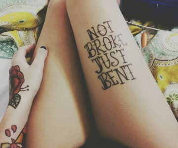 Quotes tattoos on legs