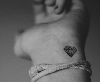 Diamonds tattoos on arms