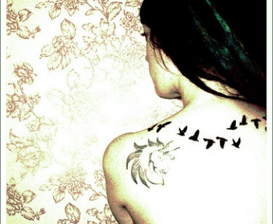 Flying Bird Silhouette Tattoo