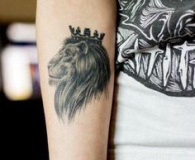 Kings styles tattoos on arms